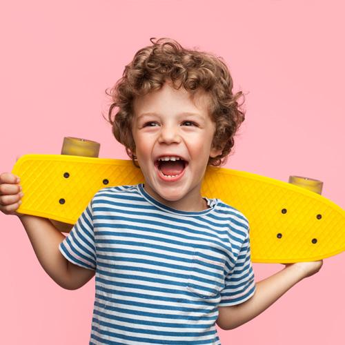 little boy with penny board skateboard